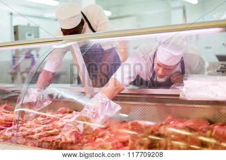 two butchers working in butchery