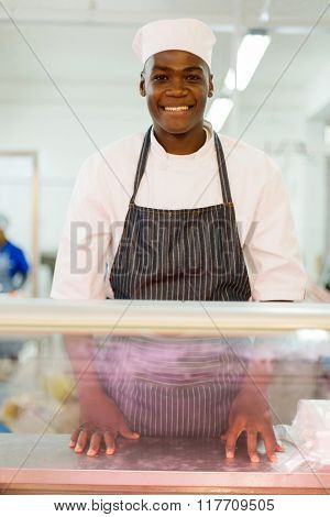 portrait of african american butcher standing in butchery