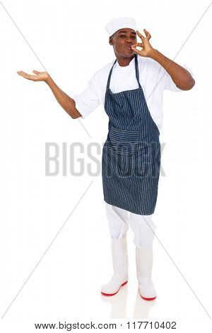 professional african american chef presenting copy space and making delicious hand sign