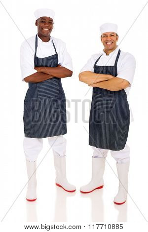 cheerful butchers with arms folded on white background