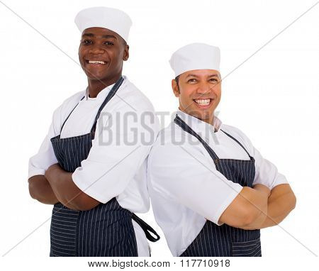 portrait of cheerful restaurant chefs arms crossed