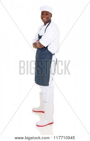 side view of successful young african chef looking at the camera