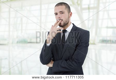businessman smoking isolated at the office