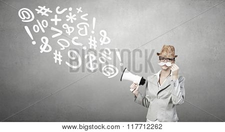 Businesswoman trying paper mustache