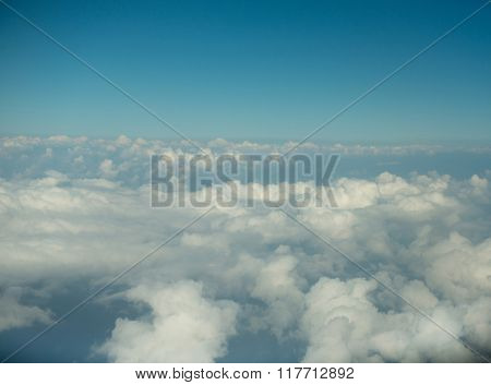 Cloudscape. Blue sky and white cloud. Sunny day. view from the airplane