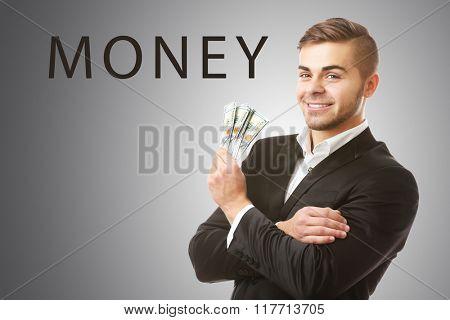 Man holding money on grey background