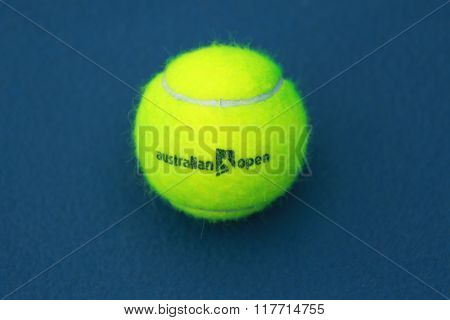 Wilson tennis ball with Australian Open logo on tennis court