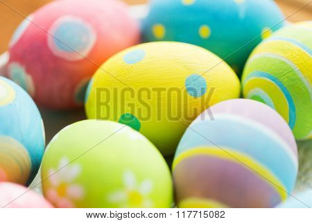 easter, holidays, tradition and object concept - close up of colored easter eggs