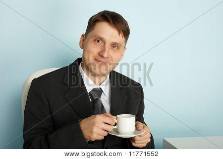 Handsome Businessman Drinking Coffee