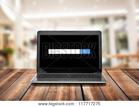 technology and advertisement concept - laptop computer with empty internet browser search bar on screen