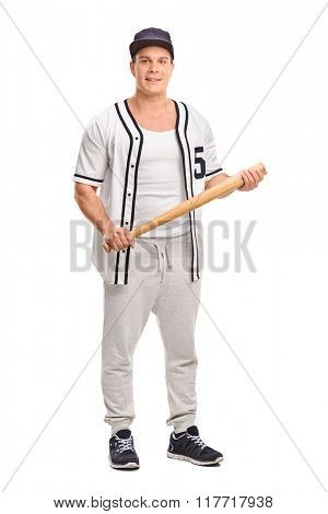 Full length portrait of a male baseball player holding a baseball bat and looking at the camera isolated on white background
