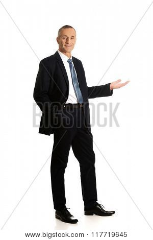 Businessman holding something on his palm