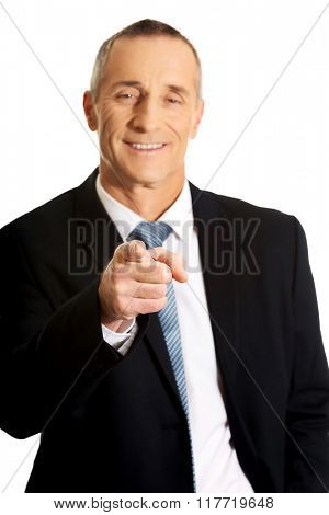 Portrait of businessman pointing on you
