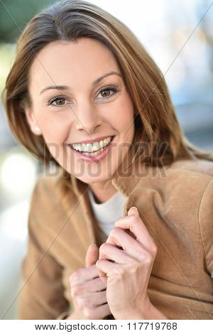 Portrait of beautiful brunette woman in city street