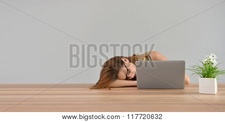 Woman falling asleep in front of laptop