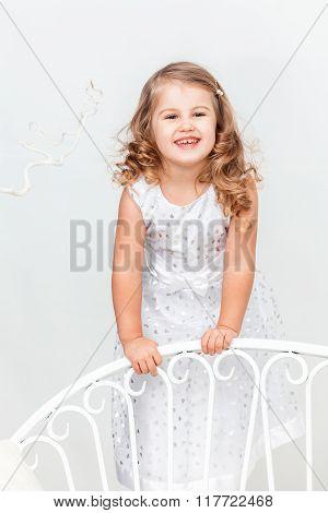 Cute, Funny Little Girl In White
