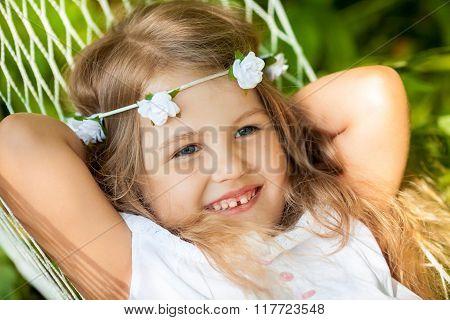 Little Girl Lying On Hammock