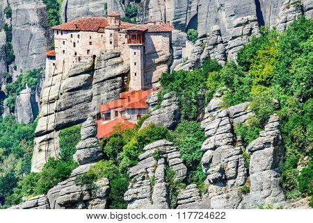 Meteora Greece. Mountain scenery with Meteora rocks and Roussanou Monastery landscape place of monasteries on the rock orthodox religious greek landmark in Thessaly