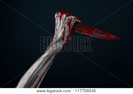 Bloody Halloween Theme: Zombie Killer Holding A Large Bloody Knife Isolated On Black Background In S