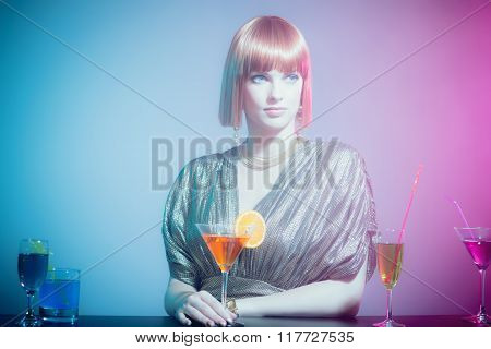 Glamorous Woman With Martini At Bar In Disco Club