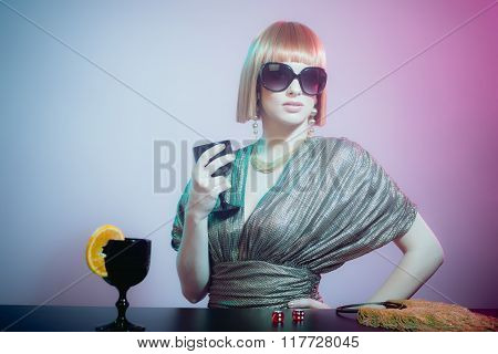 Woman In Sunglasses At Bar Holding Wine Glass