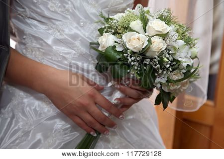Beautiful Wedding Bouquet Of White Roses In The Brides Hand