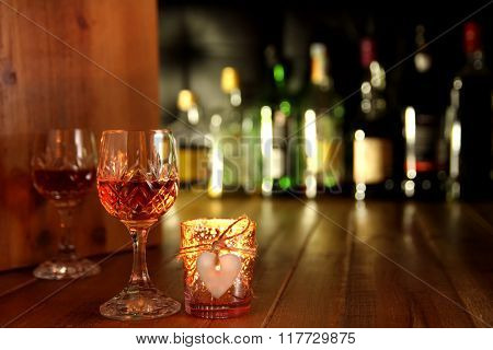 Valentines Day Romantic Candlelight Drinks with Heart and bottles in background