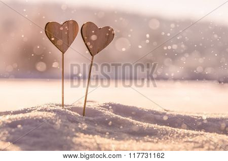 Two wooden hearts in snow - original wedding background