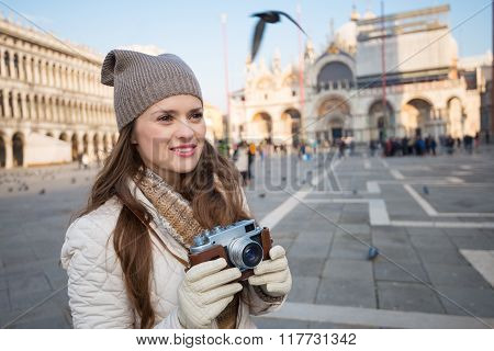 Young Woman Holding Retro Photo Camera On Piazza San Marco