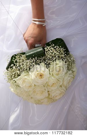 Beautiful Wedding Bouquet Of White Roses In The Bride's Hand