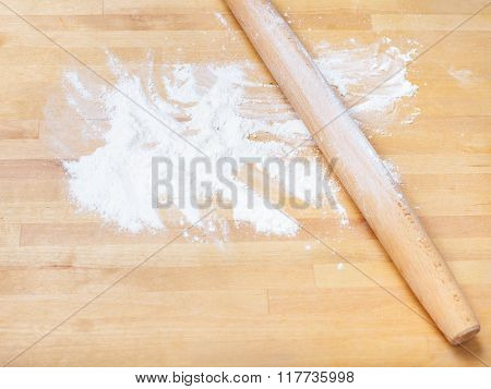 Flour And Rolling Pin On Wooden Table