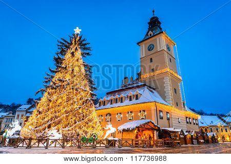 Brasov Romania. Night image of Christmas Market in Brasov. Main Square and Council House landmark of Transylvania Romania.