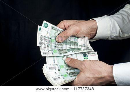 Man counts russian rubles