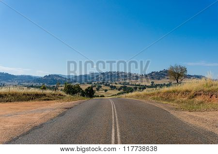 Australian outback road. Rural road on sunny day. Young region NSW Australia
