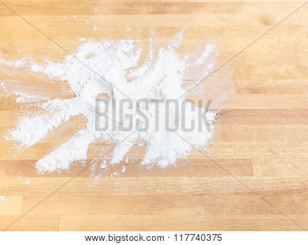 Handful Of Wheat Flour On Wooden Table