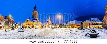 BRASOV ROMANIA - 29 DECEMBER 2014: Night image of Christmas Market in Brasov December 2014. Council Square and Black Church landmark of Transylvania Romania.