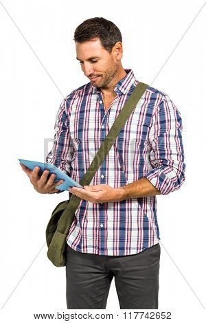 Smiling man with shoulder bag using tablet on white screen