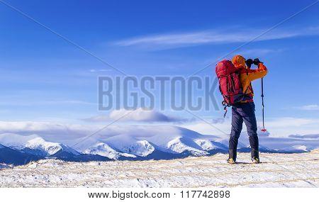 Tourist Takes A Picture