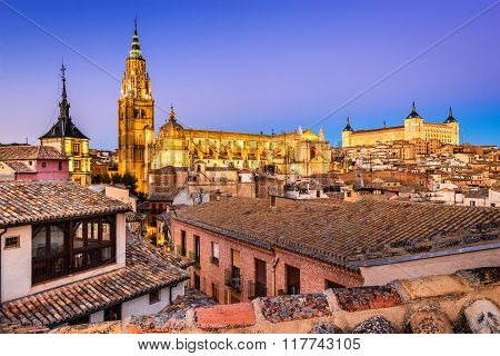 Toledo Spain. Twilight view of ancient city Toledo in Castilla la Mancha with Santa Iglesia Catedral and Alcazar landmark of Spain.