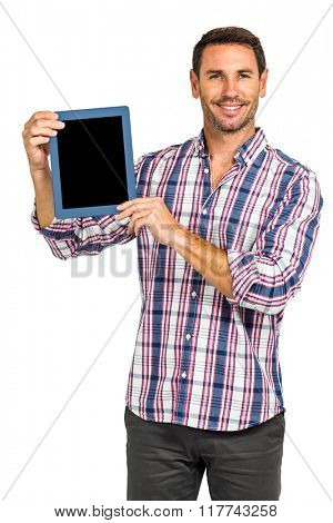 Smiling man showing tablet screen at camera on white screen