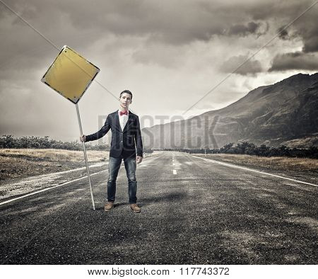 Guy showing roadsign
