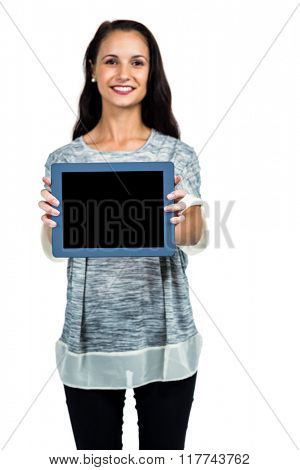 Smiling woman showing tablet screen at camera on white screen