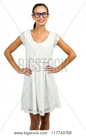 Confident woman with eyeglasses with hands on hips on white screen