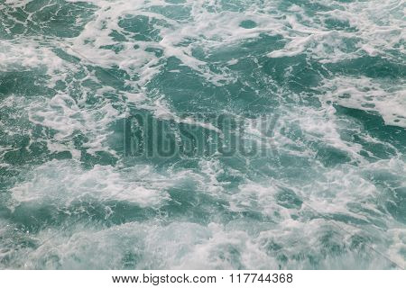 Background Of Sea Water With White  Foam