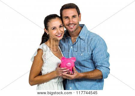 Couple holding pink piggybank on white screen