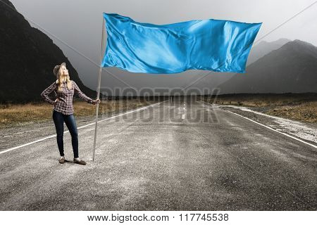 Woman with blue waving flag