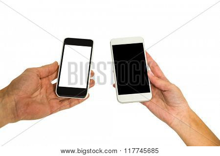 Cropped hands holding smartphones on white screen