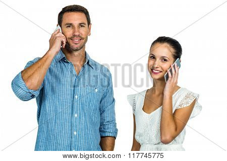 Smiling couple on phone call looking at the camera on white screen