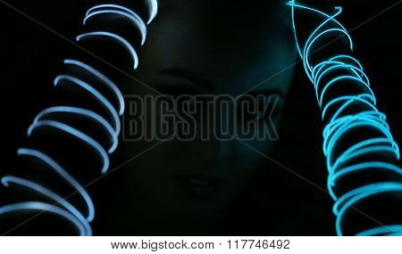 Woman with neon lights on her hands