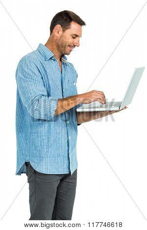 Smiling man using laptop on white screen